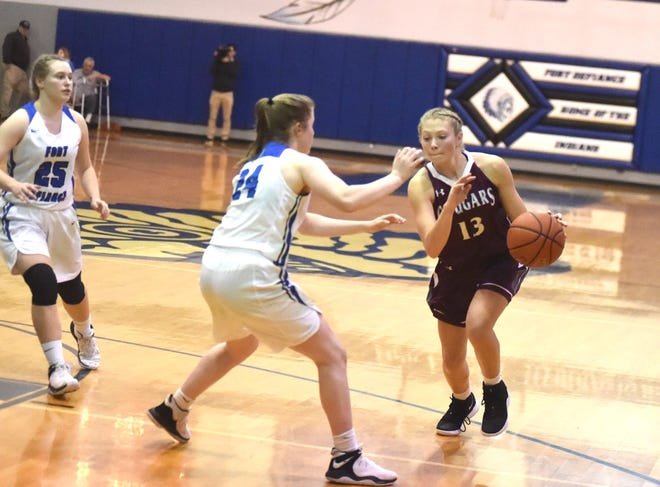 Stuarts Draft's Leah Wood tries to drive past Fort Defiance's Lilian Berry in a Shenandoah District basketball game at Fort's Don Landes Gym.