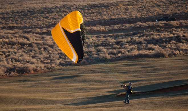 A paraglider is photographed during the annual Sand Hollow Skyfest Friday, Feb. 7, 2020. A 35-year-old man was hospitalized with serious injuries after crashing while paragliding west of St. George Friday.