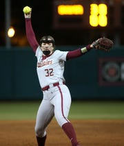 Florida State Seminoles pitcher Kathryn Sandercock (32) winds up to pitch. The Florida State Seminoles beat the Alabama Crimson Tide 8-7 in the eighth inning on Friday, Feb. 7, 2020.