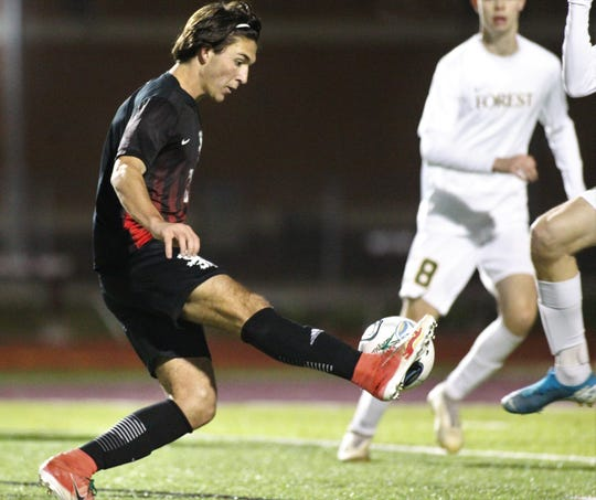Leon senior Henry Regalado dribbles as Leon's boys soccer team beat Ocala Forest 6-0 in the District 2-6A final on Feb. 7, 2020