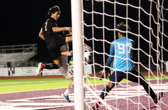 Leon senior Henry Regalado tries to score on a cross as Leon's boys soccer team beat Ocala Forest 6-0 in the District 2-6A final on Feb. 7, 2020