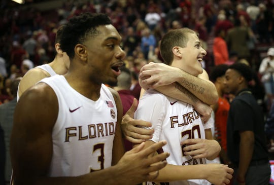 Florida State Seminoles lift up Florida State Seminoles guard Travis Light (20) after he hit two three point shots. The Florida State Seminoles beat the Miami Hurricanes 99-81 on Saturday, Feb. 8, 2020.