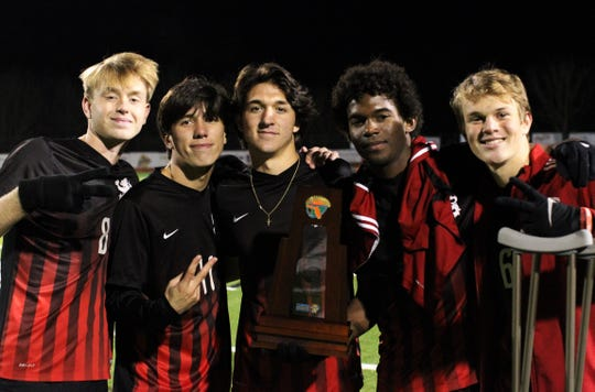 Leon's Nick Ramsden, Patrick Campo, Henry Regalado, Khari Davis and Jake Hood celebrate as Leon's boys soccer team beat Ocala Forest 6-0 in the District 2-6A final on Feb. 7, 2020