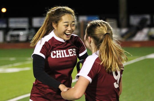 Chiles junior Emily Leonard celebrates as Chiles' girls soccer team edged Lincoln in a penalty-kick shootout following 100 minutes of scoreless soccer to capture the District 2-A title on Feb. 7, 2020.
