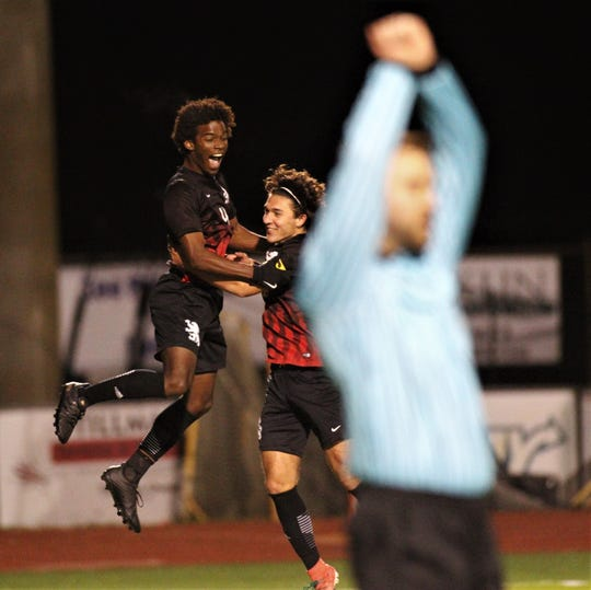 Leon junior Khari Davis celebrates his goal with Henry Regalado as Leon's boys soccer team beat Ocala Forest 6-0 in the District 2-6A final on Feb. 7, 2020