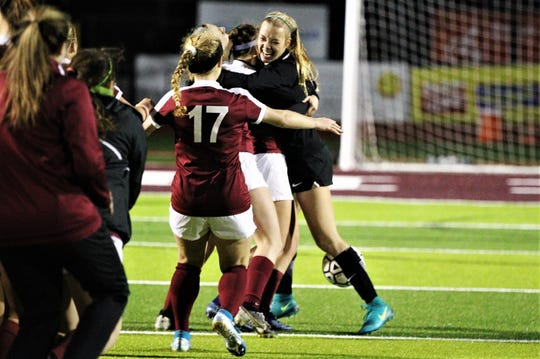 Chiles senior keeper Emily Pollard gets hugged following two PK saves as Chiles' girls soccer team edged Lincoln in a penalty-kick shootout following 100 minutes of scoreless soccer to capture the District 2-A title on Feb. 7, 2020.