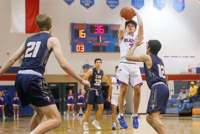 Americas' Jaden Andrus takes a shot against Coronado during the game Friday, Feb. 7, in District 1-6A boys basketball at Americas High School in El Paso.
