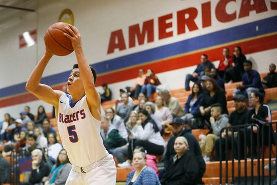Americas' Jose luis Lugo during the game against Coronado Friday, Feb. 7, in District 1-6A boys basketball at Americas High School in El Paso.