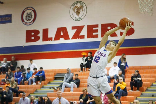 Americas' Christian Nevarez during the game against Coronado Friday, Feb. 7, in District 1-6A boys basketball at Americas High School in El Paso.