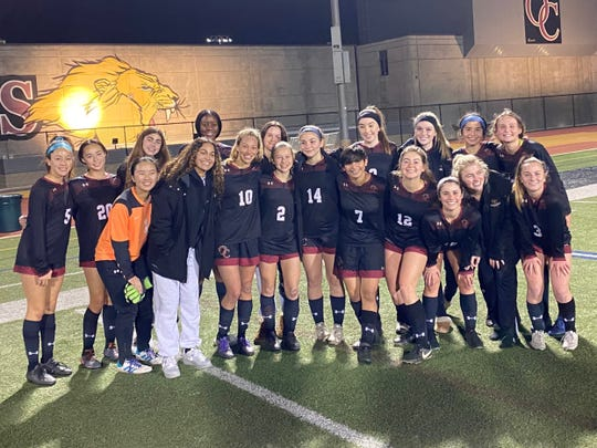 The Oaks Christian girls soccer team celebrates its 13th league title in 18 years on Thursday after a 2-0 win over Newbury Park.