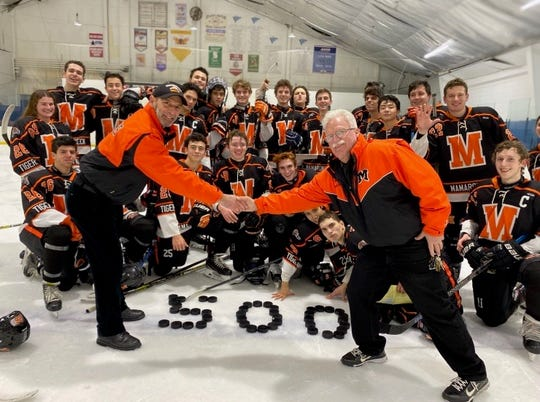 Assistant coach Art Bruno (l) and head coach Mike Chiapparelli (r) celebrate their 500th win with Mamaroneck' High's varsity ice hockey team Feb. 7, 2020..Five-hundred high school ice hockey coaching wins is No. 1 in Section 1 and No. 3 in New York.