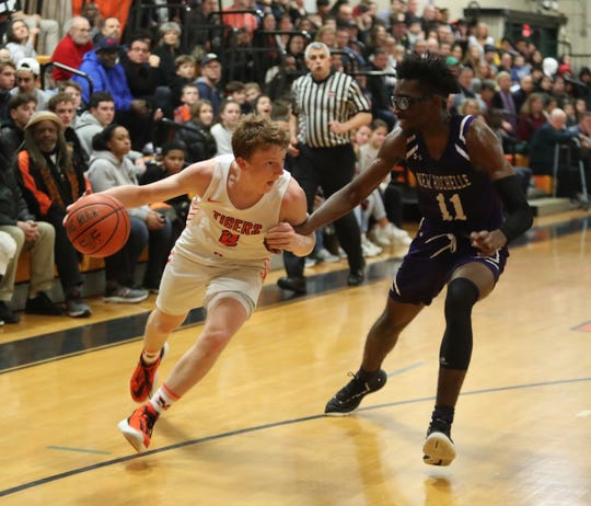 Mamaroneck's Will Webb (2) works against New Rochelle's Promise Opurum (11) in boys basketball action at Mamaroneck High School on Friday, February 7, 2020.