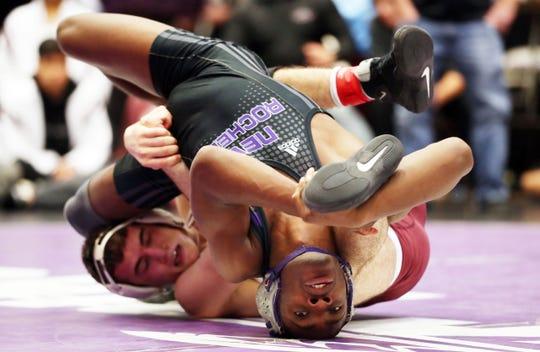 From right, New Rochelle's Cameron Burell on his way to defeating Harrison's Tyler Joesph in the 145-pound weight class during the divisional wrestling tournament at John Jay High School in Cross River Feb. 8, 2020.