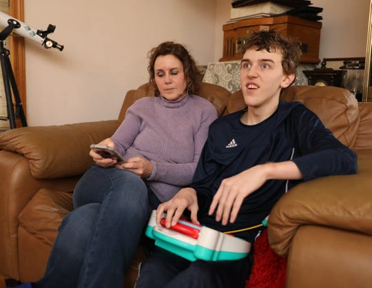 Jean Flynn is pictured with her son Ruairi Hartnett, 19, at Rhonda Parsons' home in Wesley Hills, Feb. 8, 2020.