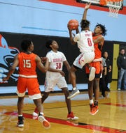Hirschi's Ernest Young (0) attacks the rim with Burkburnett's Tre'von Dean defending. Hirschi's Gabe Colbert and Burkburnett's Doriean Smith look on during District 6-4A action at Hirschi Fieldhouse on Friday, Feb. 7, 2020.