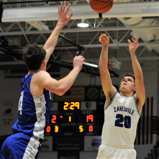 Zanesville's Mikah Fikes puts up a shot against a Cambridge defender in Friday's 61-35 loss.