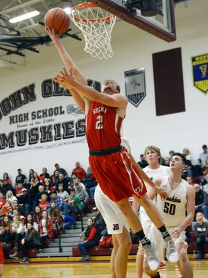 Sheridan's Landen Russell goes up for a shot against John Glenn last season. Russell is one of five seniors returning for coach Doug Fisher and the Generals, who look to defend their MVL title.