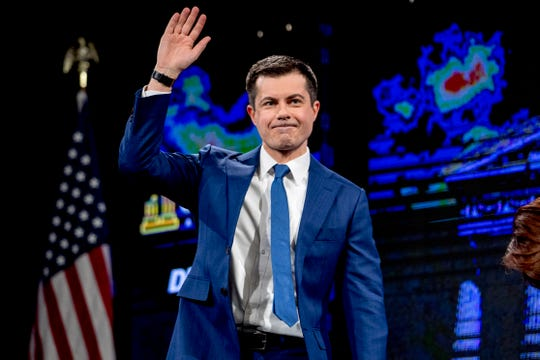 """Democratic presidential candidate Pete Buttigieg, the former mayor of South Bend, Indiana, waves after speaking at the """"Our Rights, Our Courts"""" forum at New Hampshire Technical Institute's Concord Community College on Saturday."""
