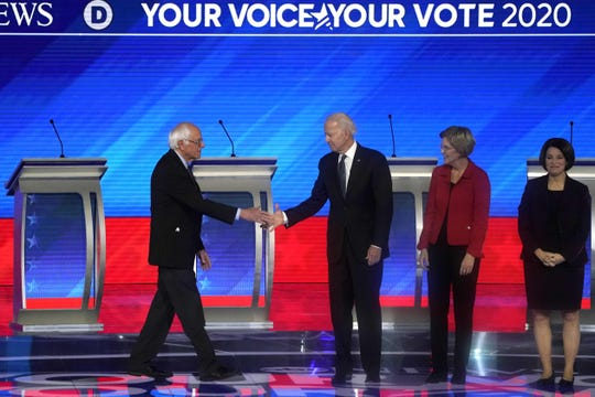 Democratic presidential hopefuls Vermont Senator Bernie Sanders, former Vice President Joe Biden, Massachusetts Senator Elizabeth Warren, Minnesota Senator Amy Klobuchar and Billionaire activist Tom Steyer arrive onstage for the eighth Democratic primary debate of the 2020 presidential campaign season co-hosted by ABC News, WMUR-TV and Apple News at St. Anselm College in Manchester, New Hampshire, on February 7, 2020.