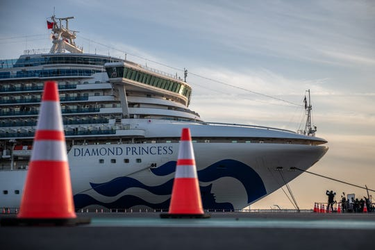 The Diamond Princess cruise ship sits docked at Daikoku Pier in Yokohama, Japan, Feb. 7, 2020  where it is resupplied and people with newly diagnosed coronavirus cases taken for treatment as the ship remains in quarantine.