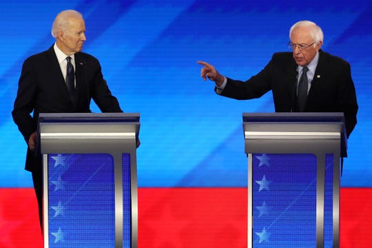 MANCHESTER, NEW HAMPSHIRE - FEBRUARY 07: Democratic presidential candidate Sen. Bernie Sanders (I-VT) speaks as former Vice President Joe Biden listens during the presidential primary debate in the Sullivan Arena at St. Anselm College on February 07, 2020 in Manchester, New Hampshire. Seven candidates qualified for the second Democratic presidential primary debate of 2020 which comes just days before the New Hampshire primary on February 11. (Photo by Joe Raedle/Getty Images) ORG XMIT: 775475047 ORIG FILE ID: 1204722838
