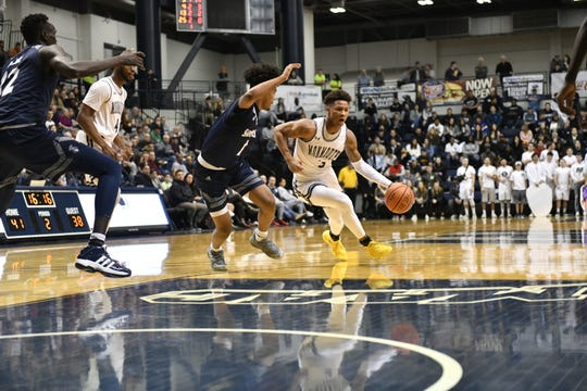 Monmouth's Deion Hammond (3) scored 30 points on Saturday at OceanFirst Bank Center in West Long Branch, but the Hawks fell to Saint Peter's, 81-69.