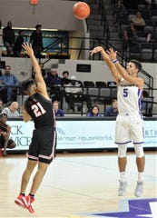 ACU's Payten Ricks, right, shoots a 3-point goal over Lamar's Ayaan Sohail in the first half. ACU beat the Cardinals 84-49 in the Southland Conference game Saturday at Moody Coliseum. Ricks hit 7 of 12 3-point goals in the game.