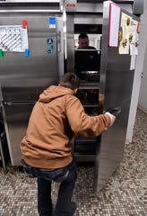 Comanche High School junior Yancy Perkins assesses the number of pancakes in the cafeteria warmer.