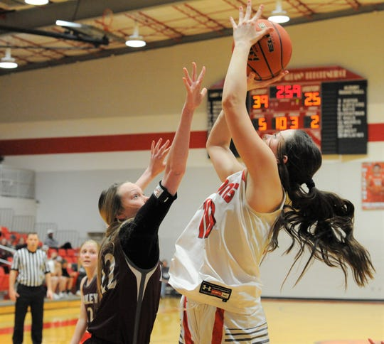 Albany junior Alli Hill goes for a shot over Hawley's McKayla Olney on Friday, Feb. 7, 2020, at Albany High School.