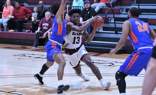 McMurry's Zacc Carter (13) drives towards the basket against Louisiana College at Kimbrell Arena. Carter finished with 11 points and eight rebounds in the 67-57 loss.