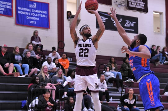 McMurry's Mike Williams takes a shot over Louisiana College's K.J. Bilbo (24) during the game at Kimbrell Arena. Williams scored a game-high 24 points and had 10 rebounds in the final home game of the senior's career.