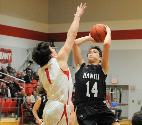 Hawley freshman Kason O'Shields (14) goes for a shot over Albany's Coy Lefevre on Feb. 7 at Albany High School.