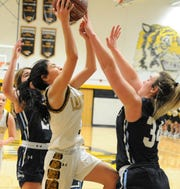 Snyder sophomore Abby Benitez goes for a layup against Midland Greenwood on Saturday, Feb. 8, 2020, at Tiger Gymnasium in Snyder.