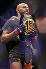 Feb 8, 2020; Houston, Texas, USA; Jon Jones (red gloves) after his win against Dominick Reyes (not pictured) during UFC 247 at Toyota Center. Mandatory Credit: Thomas Shea-USA TODAY Sports