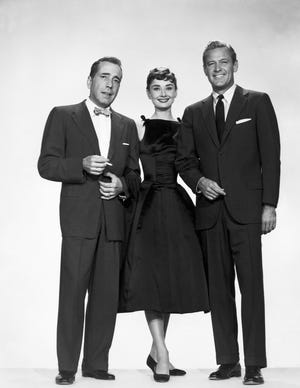 "Humphrey Bogart (from left), Audrey Hepburn and William Holden in ""Sabrina,"" which screens Feb. 14 for the Admiral Theatre's ""Dinner and a Movie"" tradition."