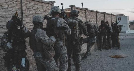 In this 2019 photo, U.S. Army Special Operations soldiers with the 7th Special Forces Group (Airborne) and U.S. Marines with the 3rd marine Aircraft Wing conduct a raid during a training exercise in California. On Saturday in Afghanistan, a number of 7th Special Forces Group (Airborne) troops were killed or injured in an incident in Nangarhar Province in eastern Afghanistan.