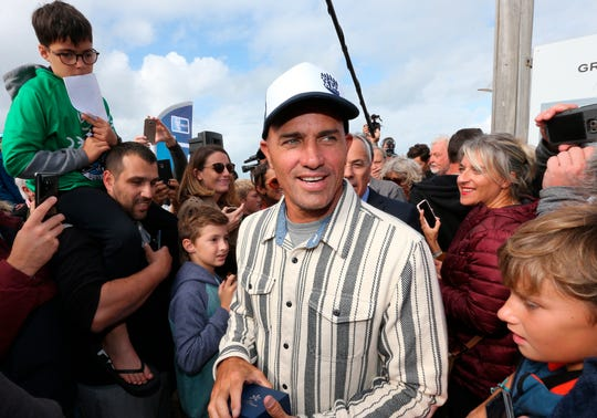 Surfer Kelly Slater was surrounded by fans after he leaves his footprint cement slab at Anglet Surf Avenue, in Anglet, France, on Oct. 9, 2019. This week, he was displaying his golf talents at Pebble Beach.