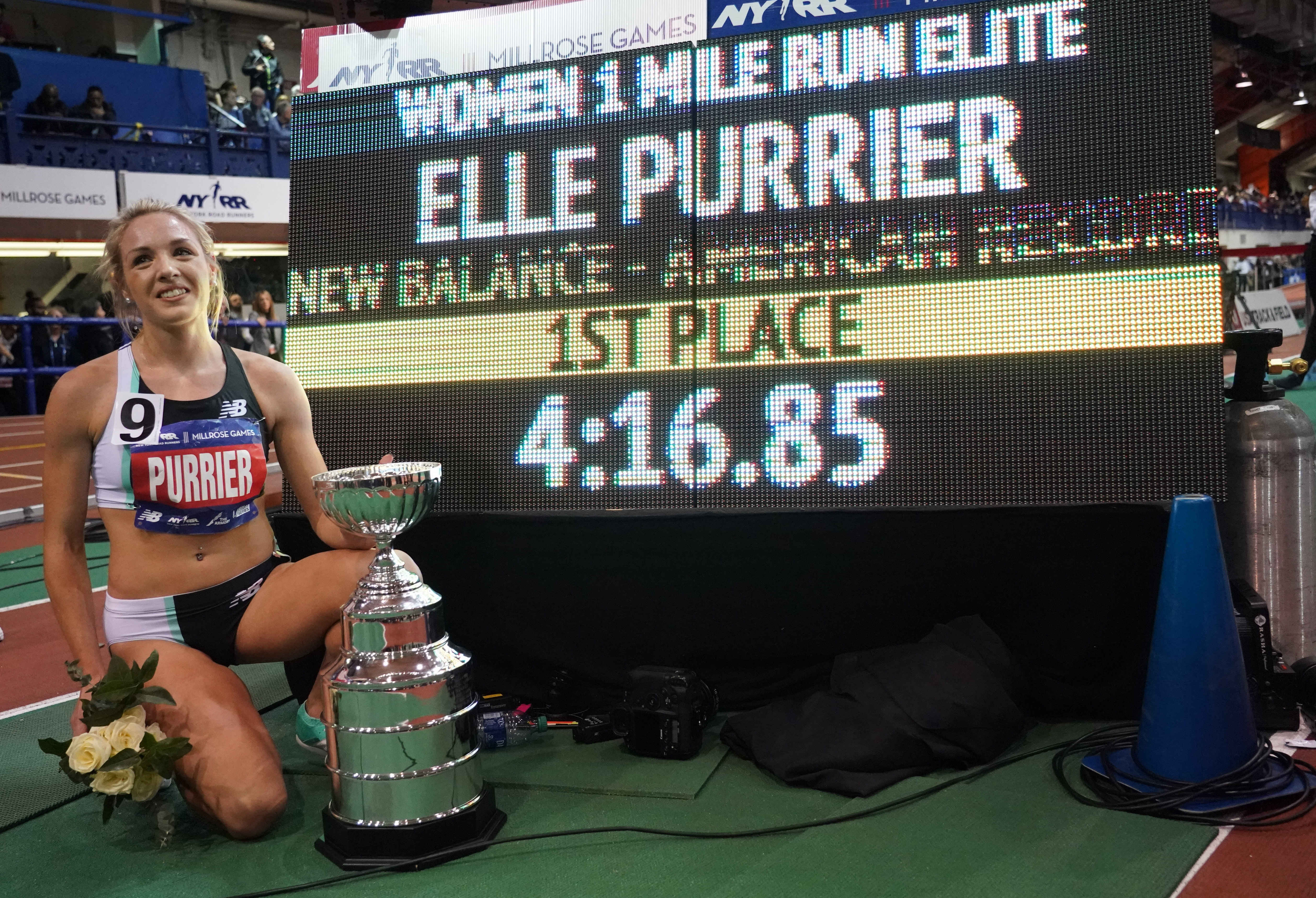 Elle Purrier (USA) poses with the scoreboard after winning the women's Wanamaker mile in an American record 4:16.85 during the 113th Millrose Games at The Armory.