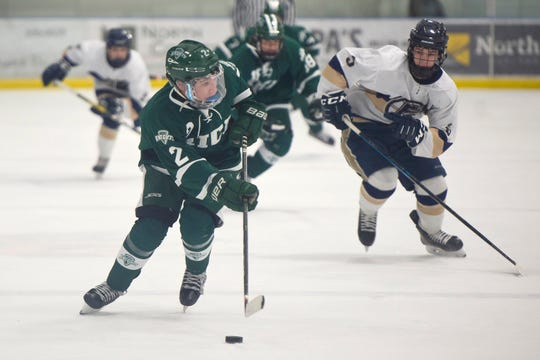Rice's Sam Rubman (2) pushes the puck up the ice during a high school boys hockey game in Essex on Saturday, Feb. 8, 2020.