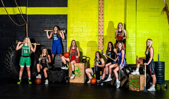 Area girl basketball players are ready to stand strong against their competition this week as the first round of tournament play begins. (L-R) Huntington's Allison Basye, Unioto's Emily Coleman, Southeastern's Macie Graves, Westfall's Marcy Dudgeon, Paint Valley's Baylee Uhrig, Adena's Hannah Stark, Waverly's Paige Carter, Zane Trace's Lauren Lane, and Piketon's Ally Ritchie. Photo taken at CrossFit Incognito in Chillicothe.