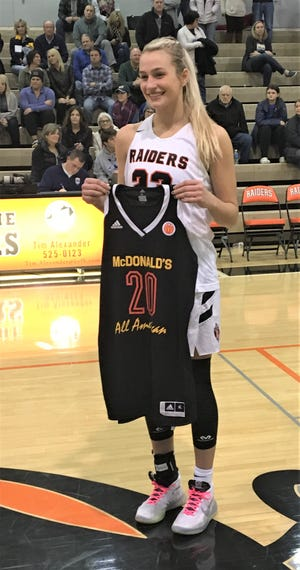 Ryle senior Maddie Scherr with her commemorative McDonald's All-American jersey, which will be framed at the school. Feb. 8, 2020.