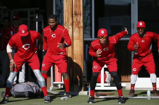 Cincinnati Reds minor league players loosen up before workouts at Cincinnati Reds spring training, Monday, Feb. 22, 2016, in Goodyear, Arizona.