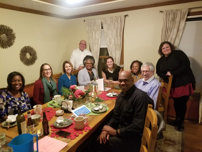 Participants in the Cincinnati USA Regional Chamber's Room at the Table program meet over dinner and conversation.