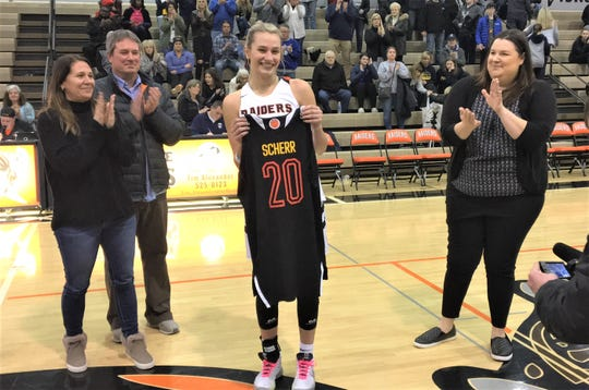 Ryle senior Maddie Scherr with her McDonald's All-American jersey and her parents Rick and Amy and head coach Katie Haitz. Feb. 8, 2020.