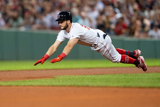 Aug 1, 2019; Boston, MA, USA; Boston Red Sox center fielder Andrew Benintendi (16) dives into second base for a double against the Tampa Bay Rays during the fourth inning at Fenway Park.