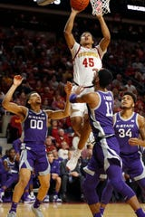 Iowa State guard Rasir Bolton drives to the basket as Kansas State guard Mike McGuirl, left, and forward Antonio Gordon (11) defend during the first half of an NCAA college basketball game Saturday, Feb. 8, 2020, in Ames, Iowa. (AP Photo/Matthew Putney)