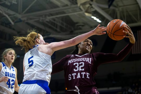 Drake's Becca Hittner and Missouri State's Jasmine Franklin reach for a rebound during the Missouri State at Drake women's basketball game on Sunday, Feb. 9, 2020, at the Knapp Center in Des Moines.