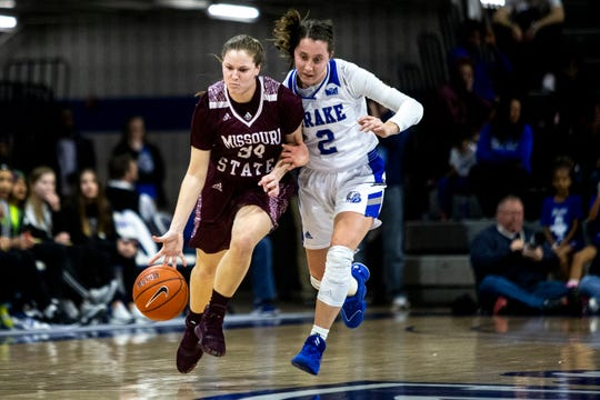 Missouri State's Sydney Manning brings the ball down the court as Drake's Maddie Monahan follows during the Missouri State at Drake women's basketball game on Sunday, Feb. 9, 2020, at the Knapp Center in Des Moines.