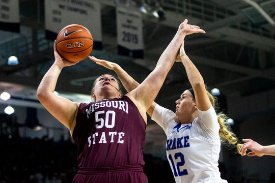Missouri State's Emily Gartner attempts to shoot as Drake's Brenni Rose defends during the Missouri State at Drake women's basketball game on Sunday, Feb. 9, 2020, at the Knapp Center in Des Moines.