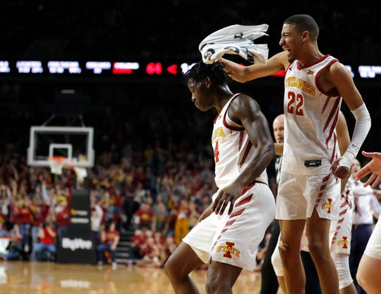 Iowa State guard Tyrese Haliburton, right, congratulates guard Terrence Lewis, left, after a Lewis' 3-point basket during the second half of the team's NCAA college basketball game against Kansas State, Saturday, Feb. 8, 2020, in Ames, Iowa. Iowa State won 73-63. (AP Photo/Matthew Putney)